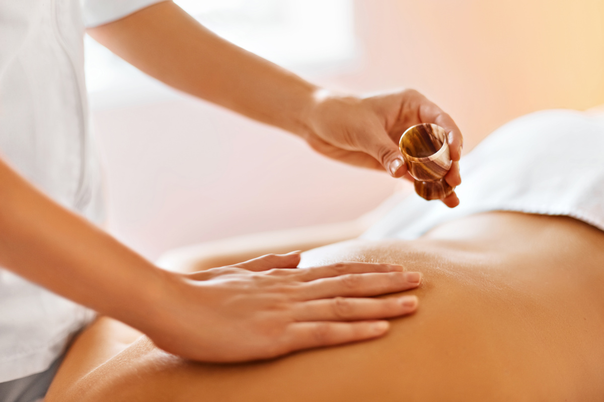 Body massage. Spa therapy. Masseur doing massage on beautiful young healthy caucasian woman body in  spa salon. Beauty treatment concept. Skincare, wellbeing, wellness, lifestyle.